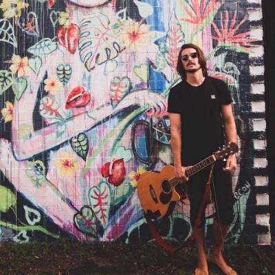 Taylor T Singing Guitarist