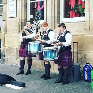 Drums and Drones Bagpiper