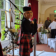 Linda Carpenter piper Bagpiper