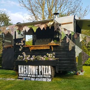 Kneading Pizza Wedding Catering