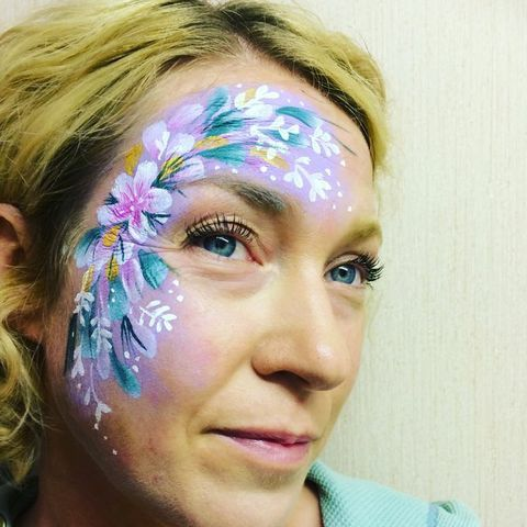 Painted Peacock Face & Glitter Painting Face Painter