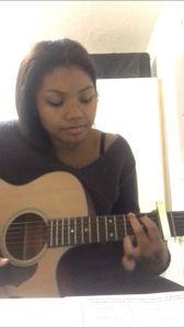 Zoe Owusu Singing Guitarist