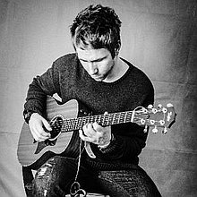 J K Simpson Singing Guitarist