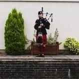 Mark Black Bagpiper