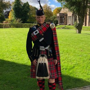 Pipe Major D McRobb Bagpiper