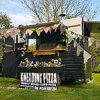 Kneading Pizza Street Food Catering